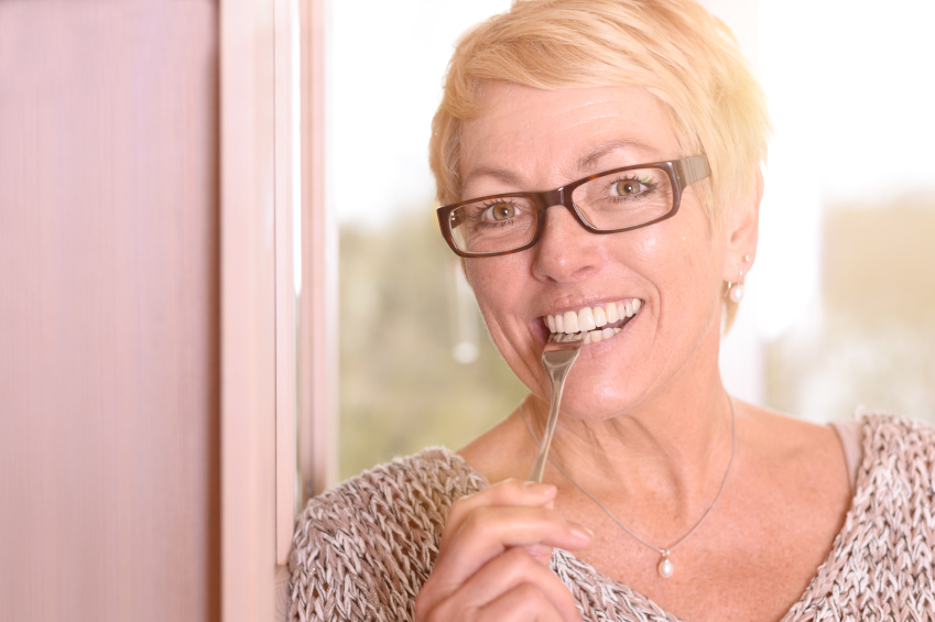 Close up Happy Blond Woman Biting a Fork
